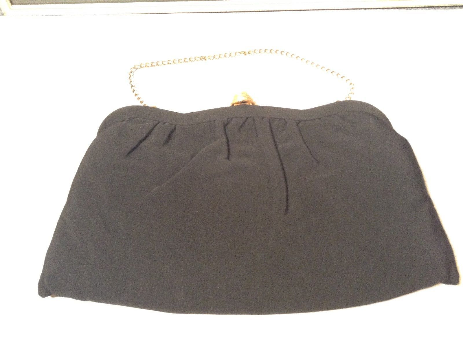 Black Smooth Handbag with Gold Tone Chain and Snake Like Clasp