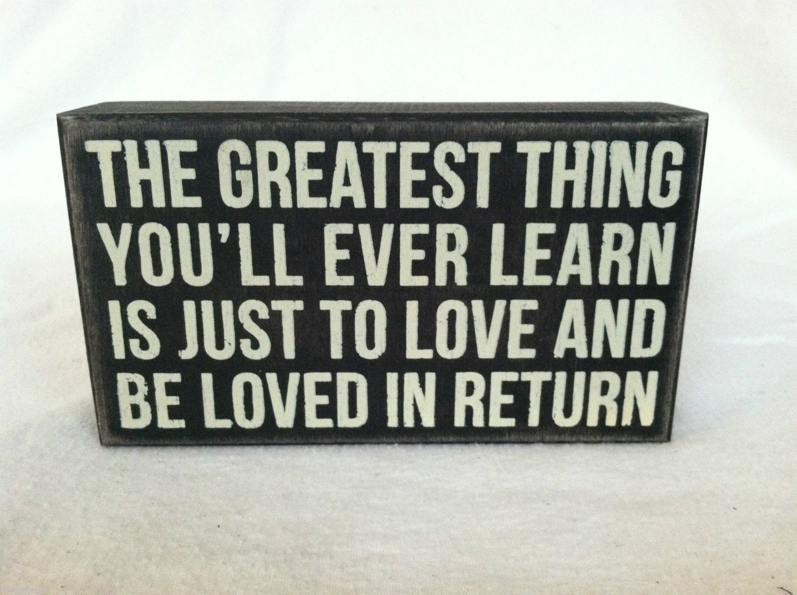 "Black Wooden Box Sign ""The Greatest Thing You'll Ever Learn is Just to Love..."""