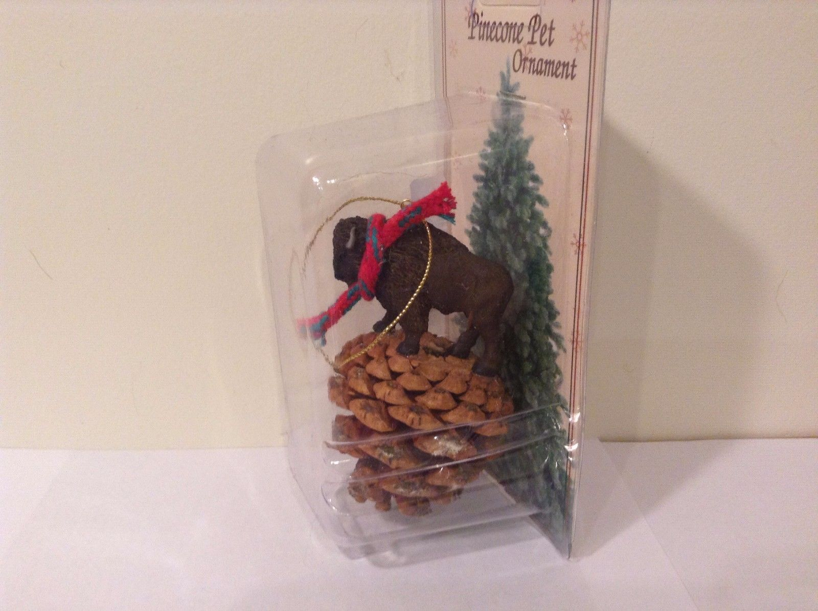Black buffalo with scarf on pine cone Christmas winter holiday ornament  NIB