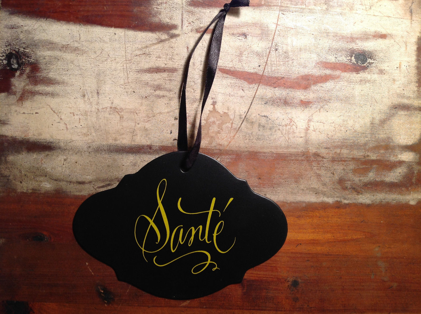 Black sign with lettering Sante yellow lettering vintage shape