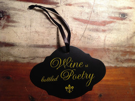 Black sign yellow lettering Wine is bottled poetry vintage shaped ribbon to hang