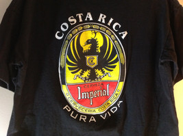 Black Short Sleeve Graphic T-shirt with White Emblem on Front Chest Size Medium image 4