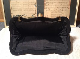 Black Smooth Handbag with Gold Tone Chain and Snake Like Clasp image 4