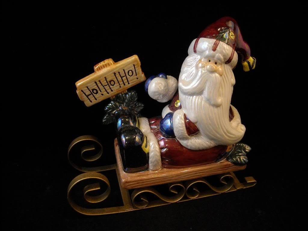 Ceramic Santa Clause Christmas figure in sled shiny glaze clay