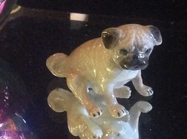 Ceramic miniature dog cute pug sitting down resting