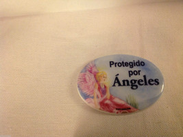 Ceramic porcelain magnet Spanish Protegido por  Angeles Protected by Angels