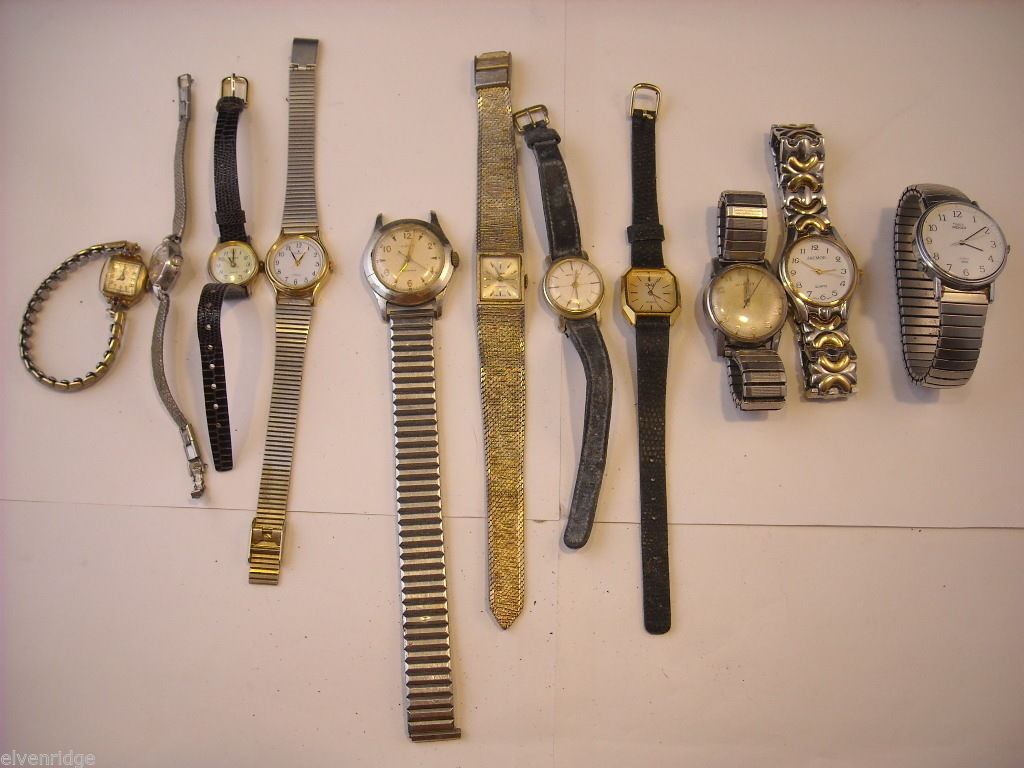 Collection of 11 vintage wrist watches with bands