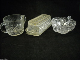 Collection of cut glass small serving pieces butter dish sugar bowl candy dish