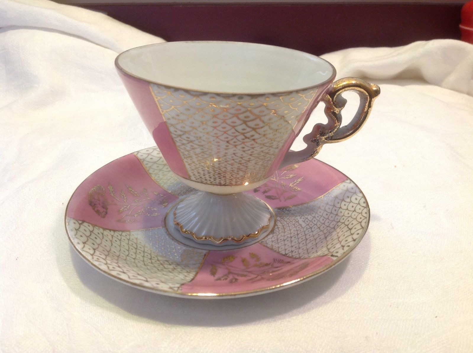 Cup saucer set pink pedestal w florals fish scale gold gilt National Potteries