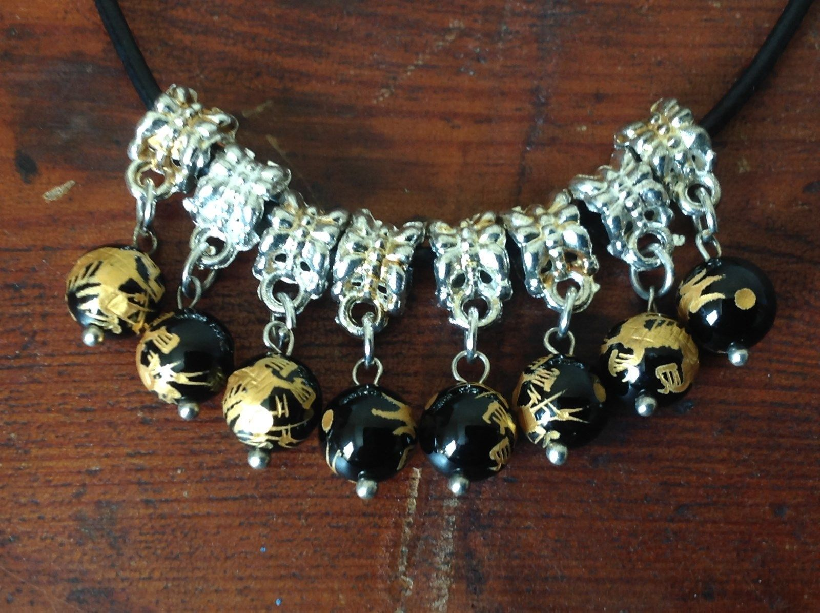 Dangling Handmade Glass Bead Necklace Silver Tone Black Gold Dragons