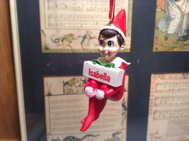 Dept 56 - Elf on the Shelf - Isabella  banner Christmas Ornament