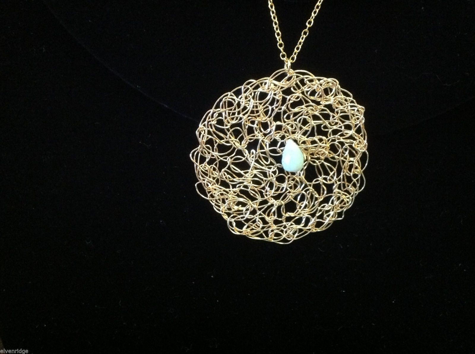 Designer gold necklace pendant with green aventurine cabochon