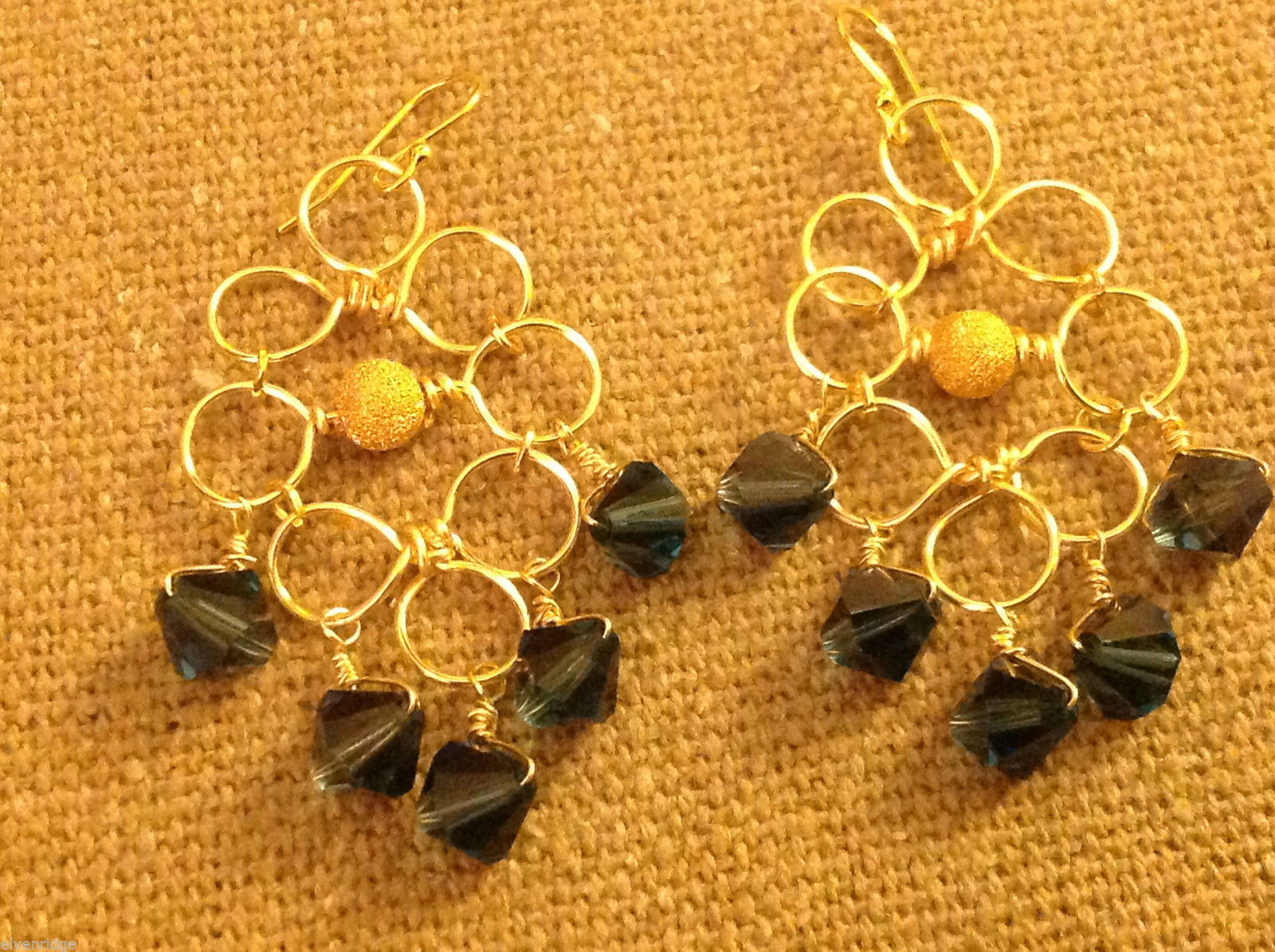 Designer gold wire earrings  with rounds and blue faceted crystals