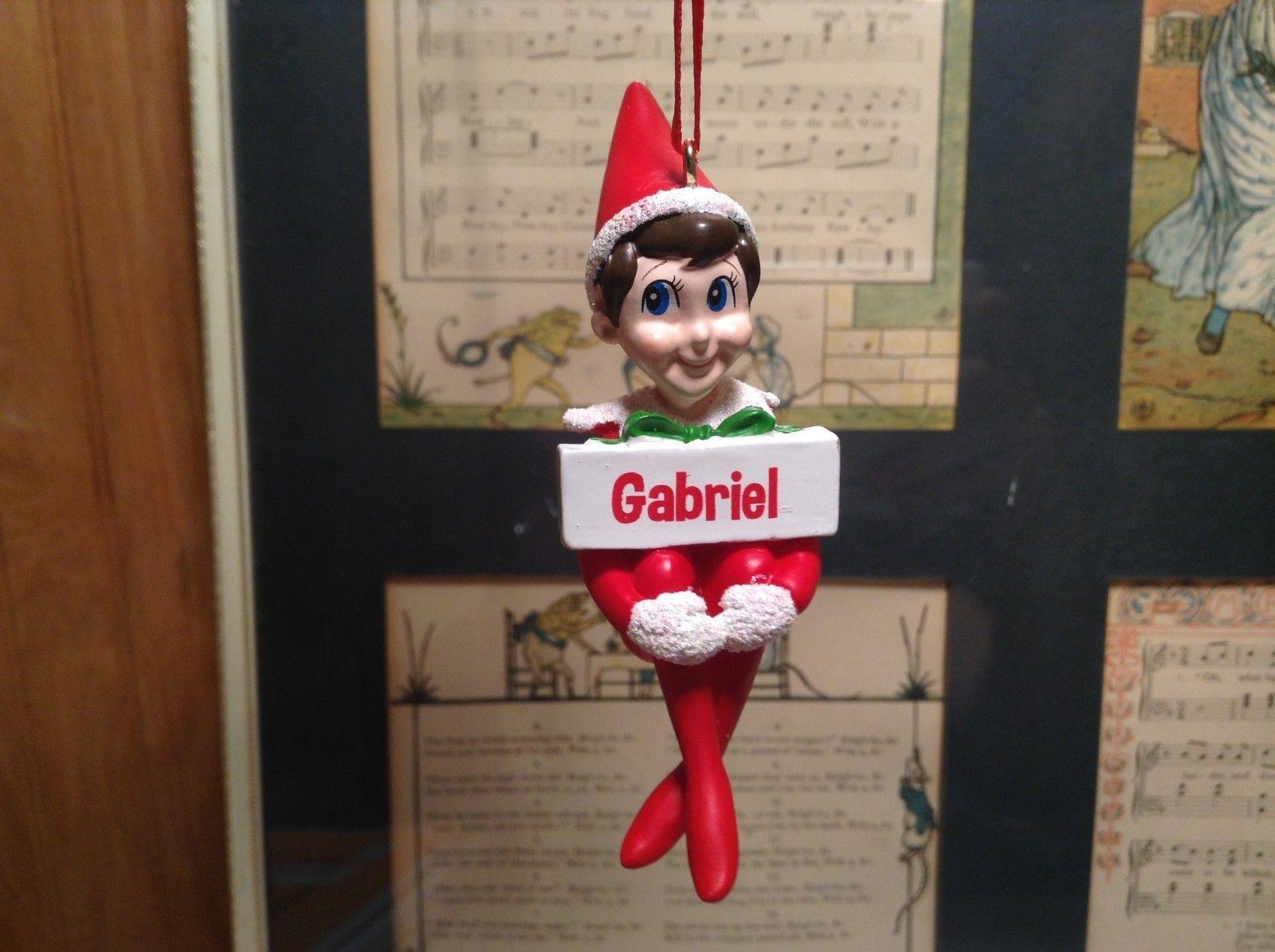 Dept 56 - Elf on the Shelf - Gabriel  banner Christmas Ornament