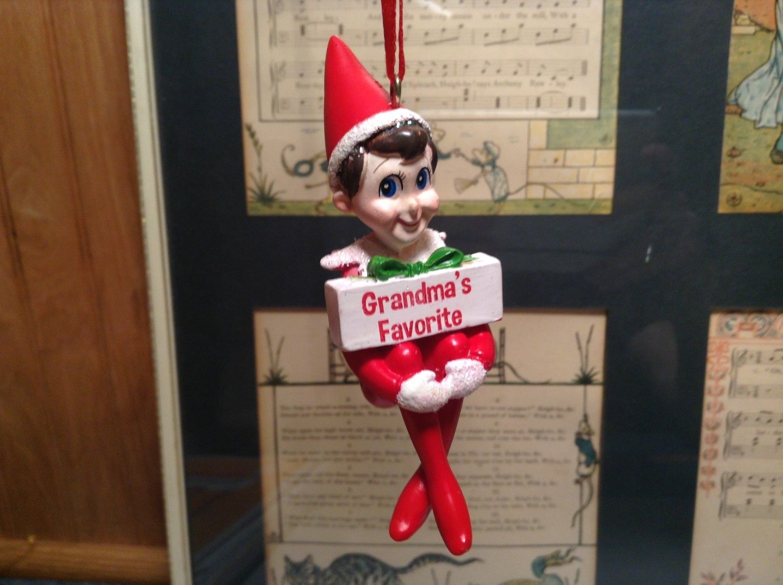 Dept 56 - Elf on the Shelf -  Grandma's Favorite banner Christmas Ornament