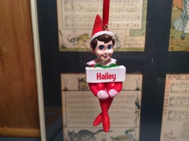 Dept 56 - Elf on the Shelf - Hailey banner Christmas Ornament
