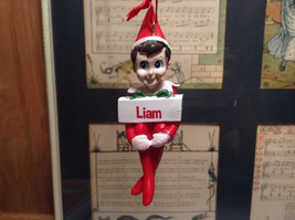 Dept 56 - Elf on the Shelf - Liam banner Christmas Ornament image 1
