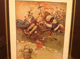 Gardeners fell asleep in the garden vintage Page From a Book Framed image 2