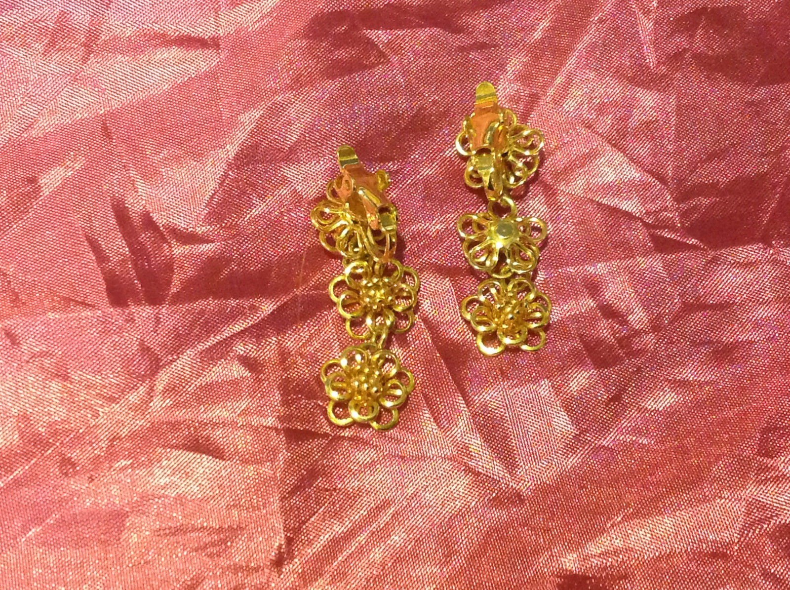 Gold Colored Clip-On Earrings with 3 Gold Colored Dangling Flowers 2.5 Inches