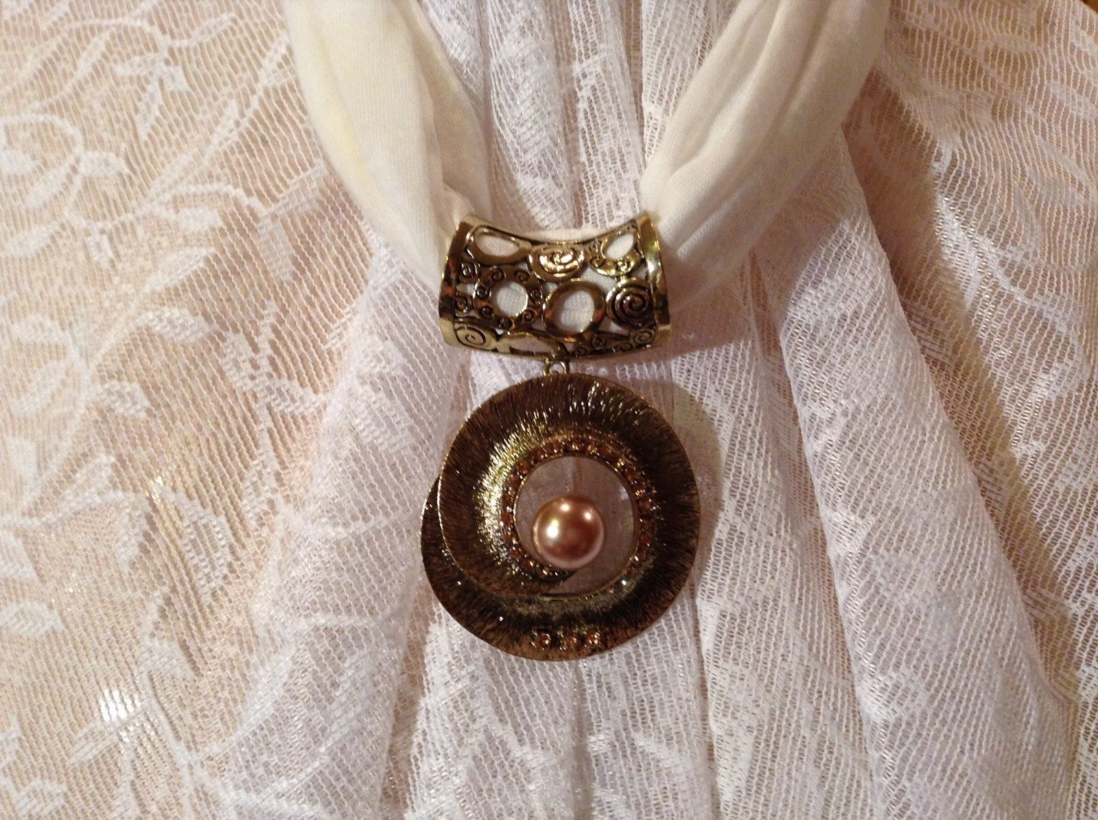 Gold Tone Spiral Circular Shaped Scarf Pendant with Large Brown Bead in Center