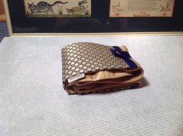Gold with Purple Compact Zipped Up Purse Buttoned Together