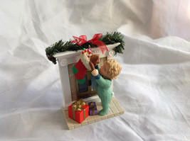 Hallmark Keepsake Reaching for Christmas Ornament Scene Near Fireplace Ornament