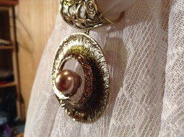 Gold Tone Spiral Circular Shaped Scarf Pendant with Large Brown Bead in Center image 6