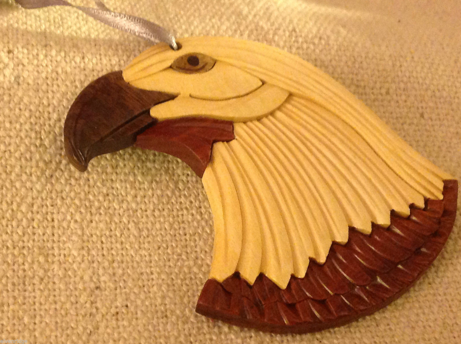 Hand carved multi colored grained wood eagle ornament double sided