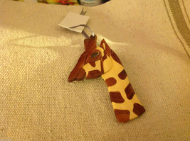 Hand carved multi colored grained wood giraffe ornament double sided