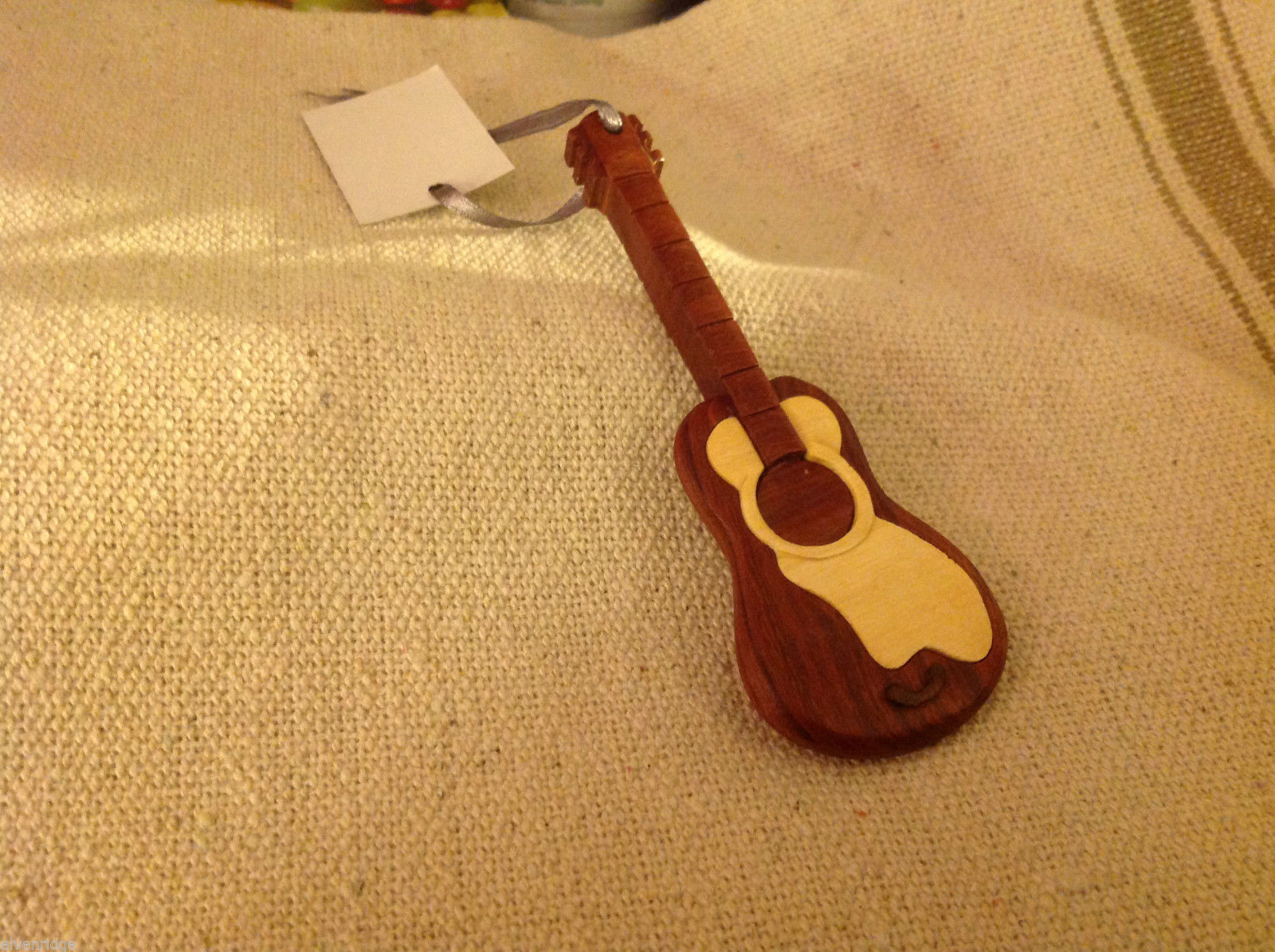 Hand carved multi colored grained wood guitar ornament double sided