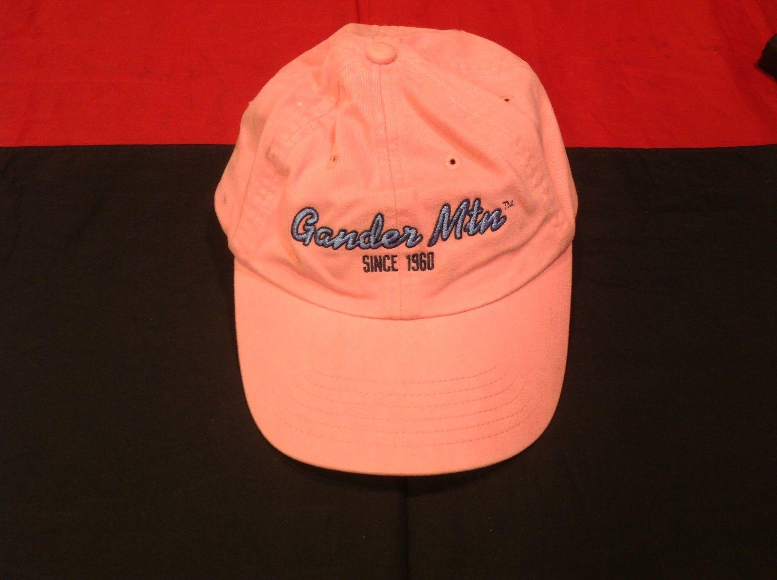 Gander Mtn Since 1960 on front of Adult Size Pink Hat We Live Outdoors on back