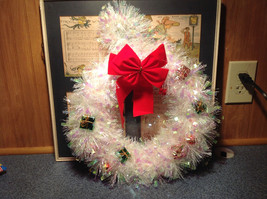 Glittery White Ribboned Holiday Wreath with Mini Presents and Red Ribbon