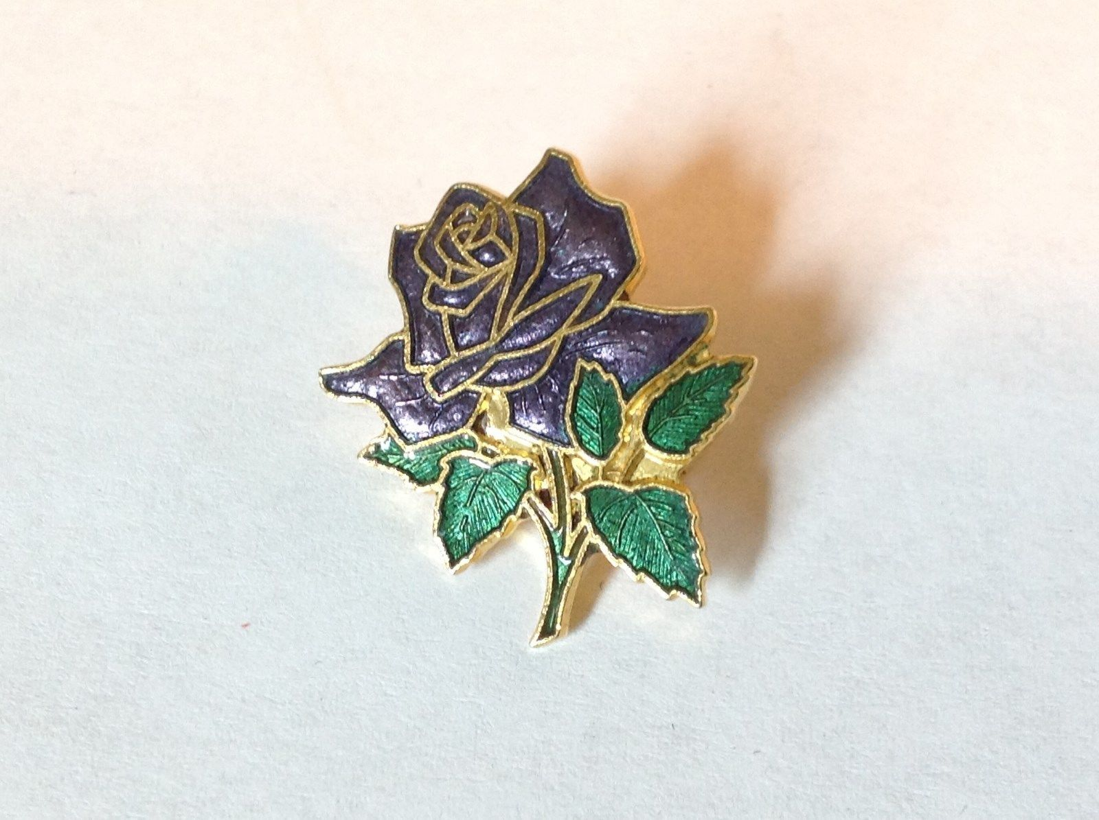 Gold Tone Violet Flower Rose with Green Leaves Pin