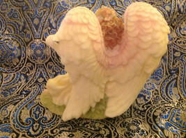 Gentle Angel holding a butterfly in repose in the garden image 4