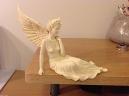 Graceful angel sitter girl with glitter wings flowing gown sitting reclined - $39.99
