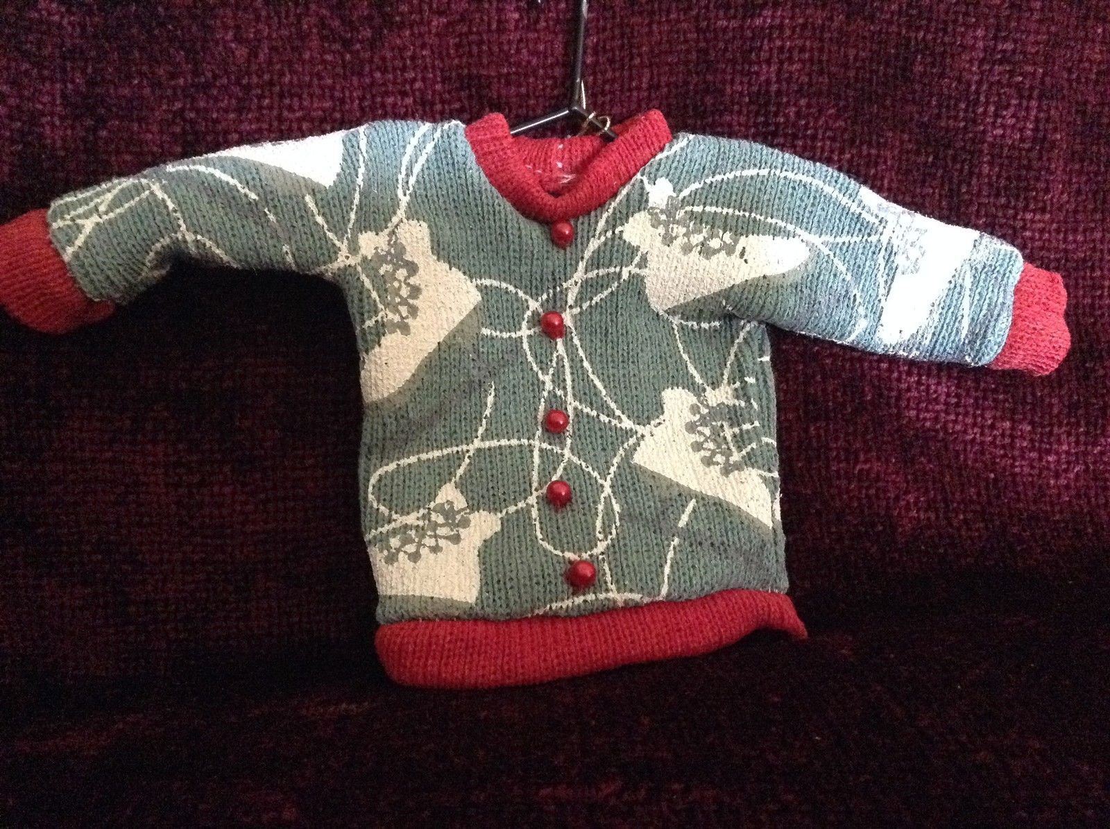 Gray Poseable Ugly Sweater Ornament White Skates Red Trim and Small Red Buttons