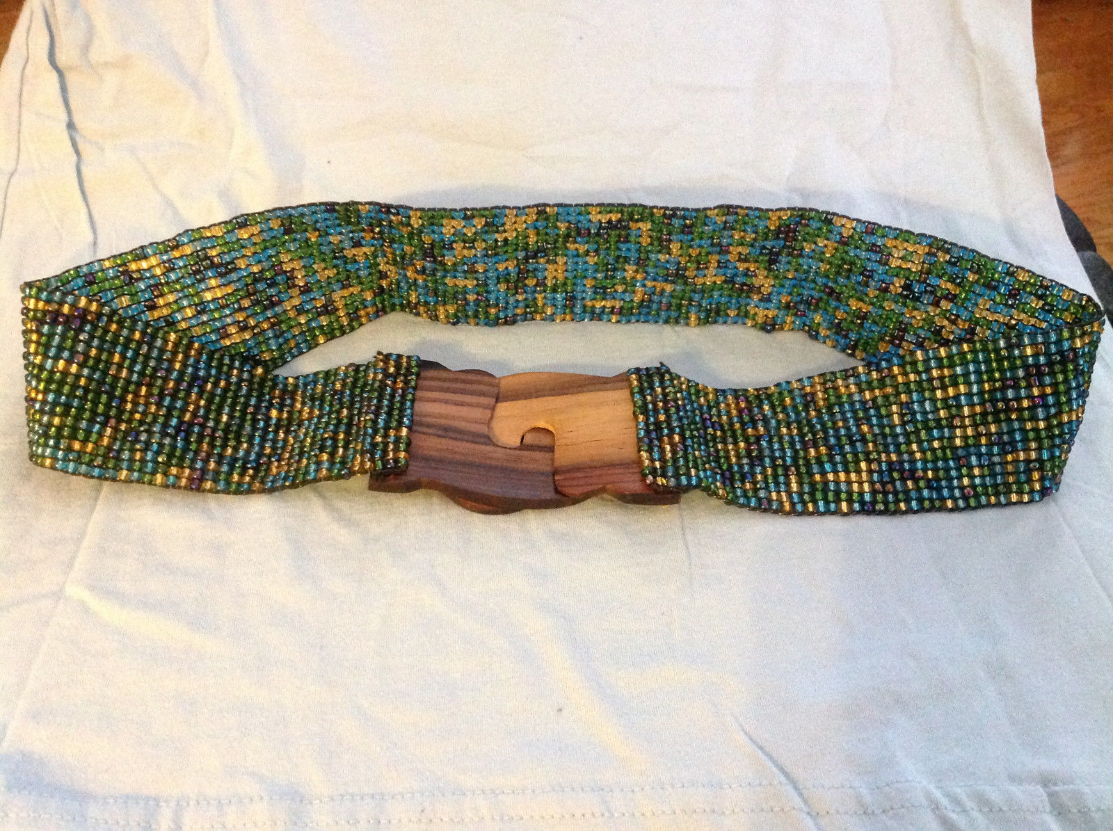 Green blue yellow beaded elastic belt wood closure slips together to close