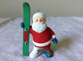 Hallmark Keepsake Ornament Christmas Break Santa has a Cast on Holding a Sled