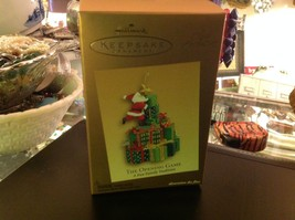 Hallmark ornament Santa and Unwrapping First Christmas Gift Game