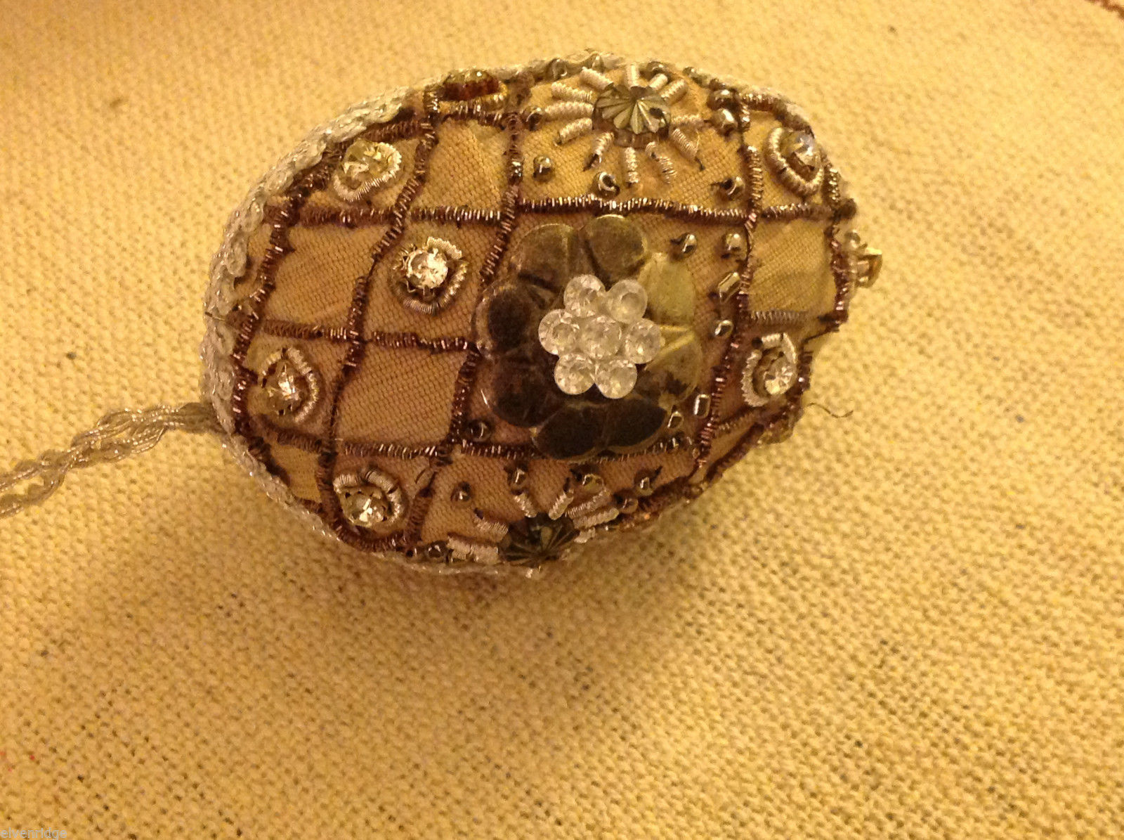 Hand beaded sequined adorned egg with raw silk in brown ornament
