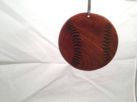 Hand carved multi colored brown shades wooden Baseball ornament double sided - $39.99