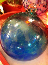 Hand blown large heirloom glass Christmas ornament in blue and teal swirl