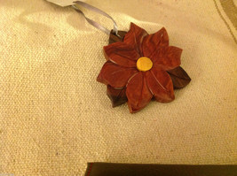 Hand carved multi colored grained wood Poinsettia floower ornament double sided