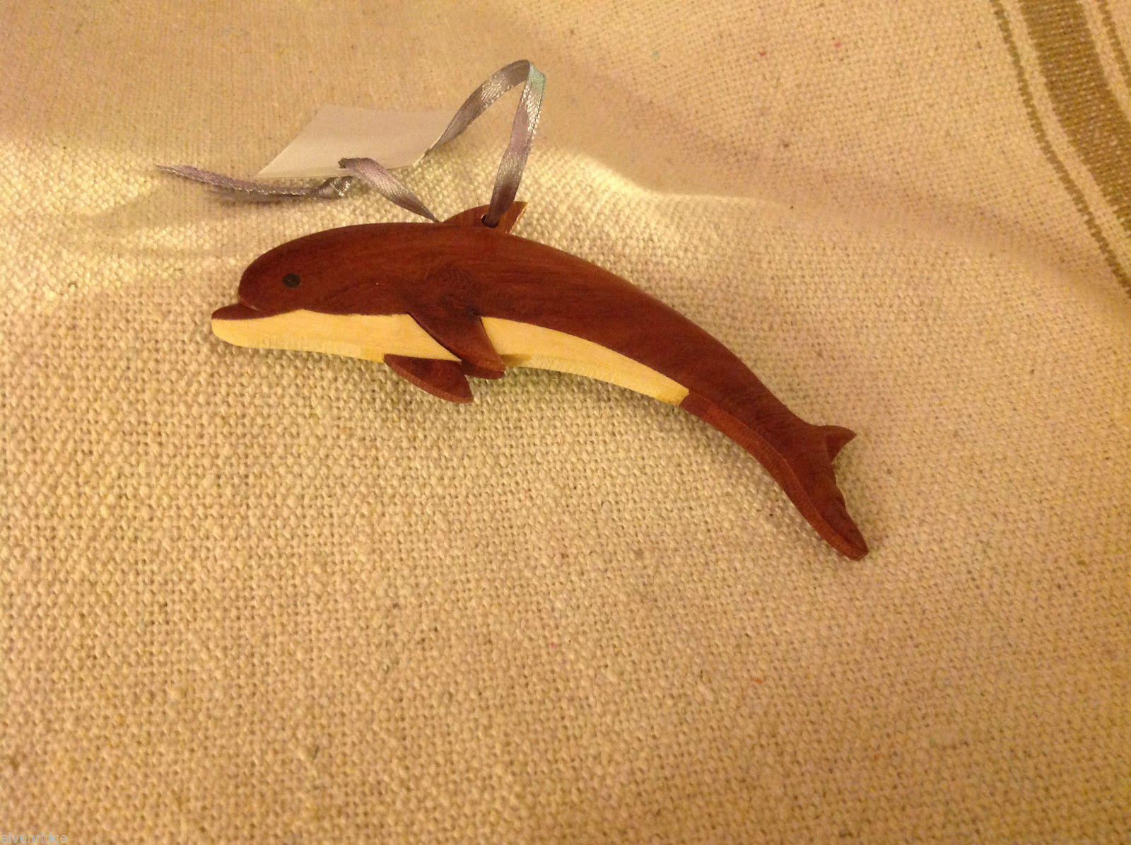 Hand carved multi colored grained wood dolphin ornament double sided