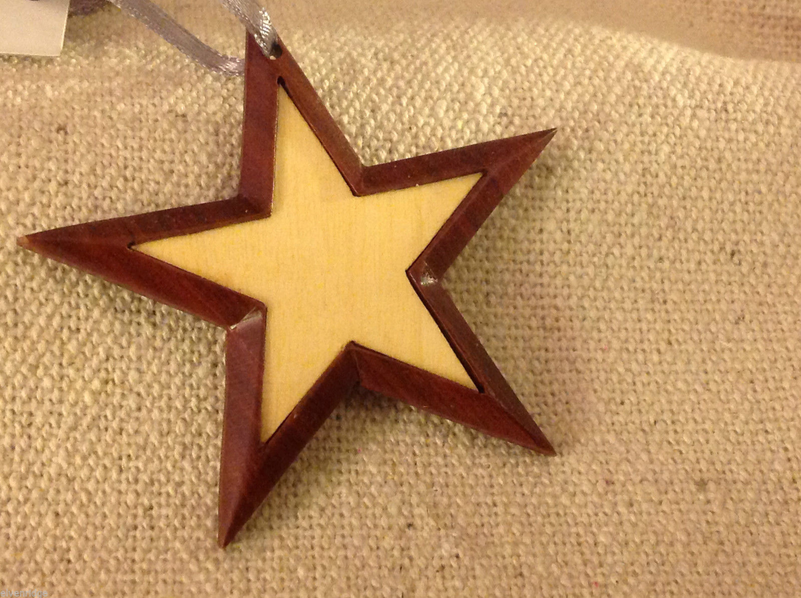 Hand carved multi colored grained wood five point star ornament double sided