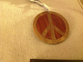 Hand carved multi colored grained wood peace sign ornament double sided