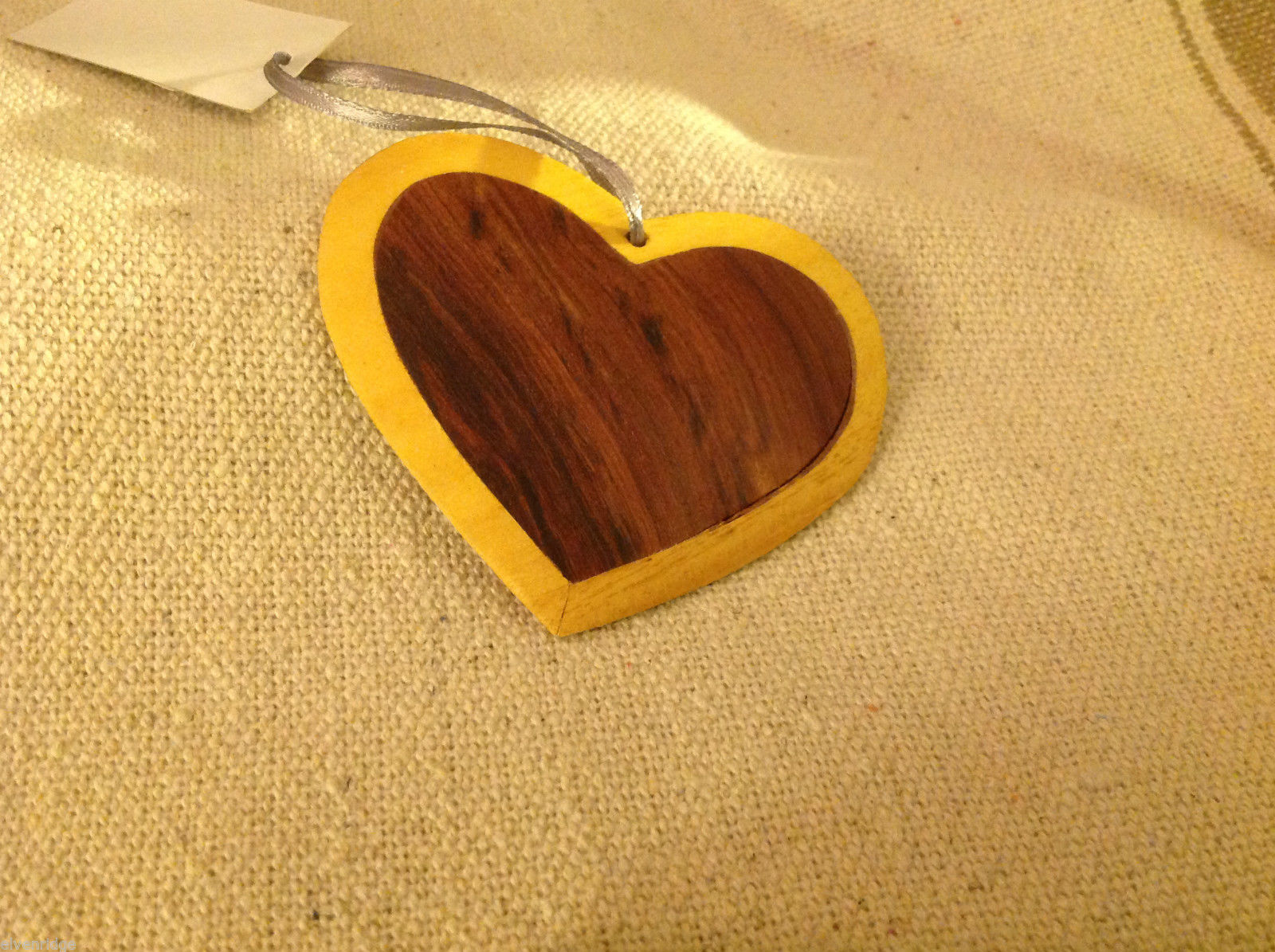 Hand carved multi colored grained wood heart ornament double sided