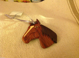 Hand carved multi colored grained wood horse ornament double sided