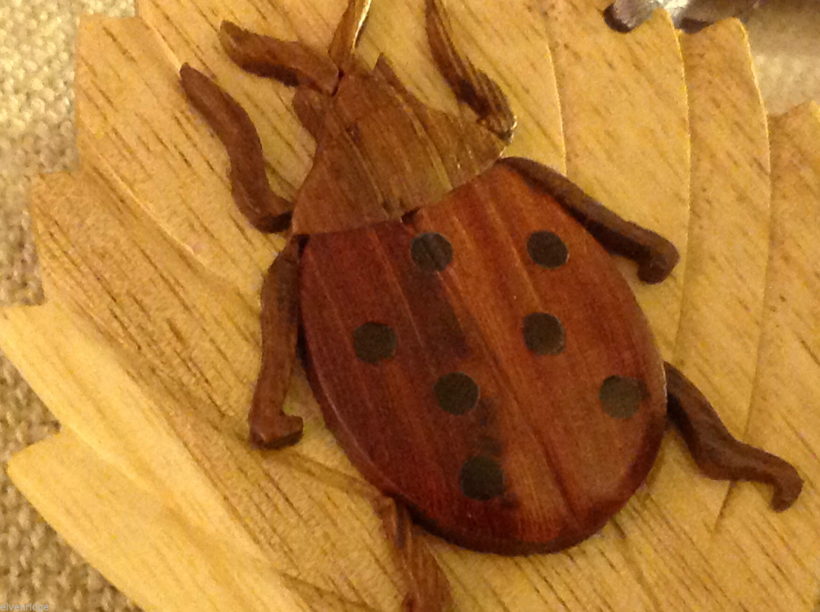 Hand carved multi colored grained wood ladybug ornament double sided