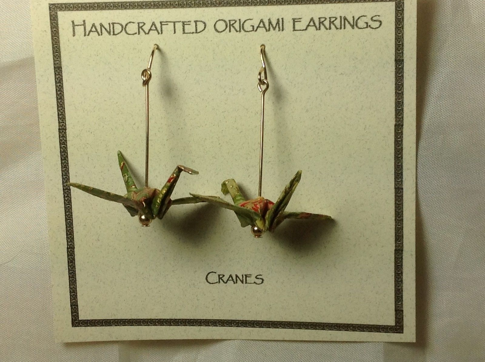 Handcrafted real gold origami crane earrings